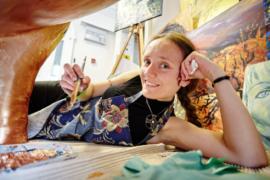 Lois Cordelia painting an art trail sculpture.